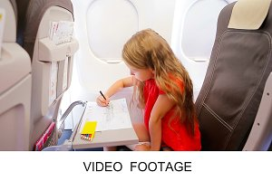 Kid drawing picture in plane