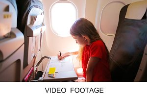 Kid drawing near aircraft window