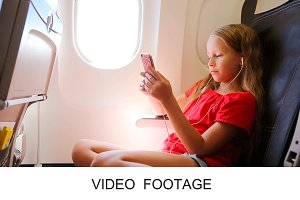 Kid listening music aircraft window
