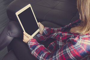 Hipster holding a white Ipad