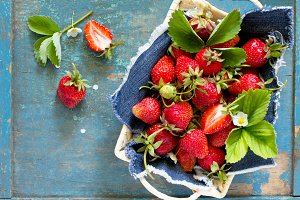 Harvest of fresh ripe strawberries
