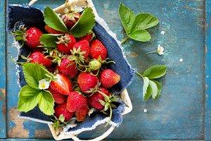 Harvest of fresh ripe strawberries