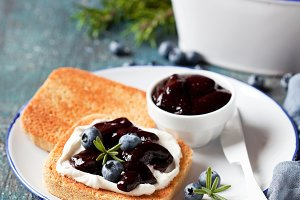Toast with cream cheese and blueberry jam