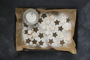 Homemade Christmas shortbread star shape sugar cookies with  powder.
