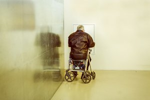 Senior sitting on a walker
