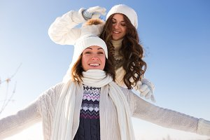 Two girl having fun. Winter outdoor