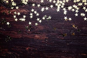 Background with golden glitter stars