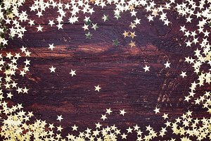 Golden glitter stars on wood