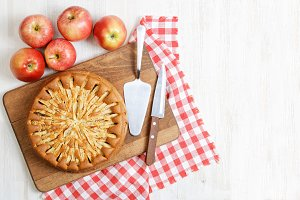 Homemade apple pie on white table.