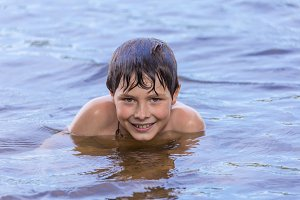 Little boy in lake