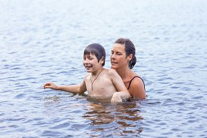 Mother and son in a lake