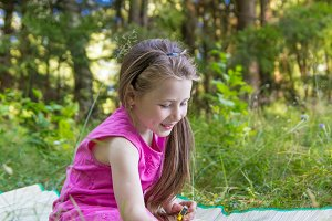 Little girl draw outdoors