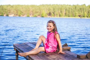 Little girl near lake outdoors