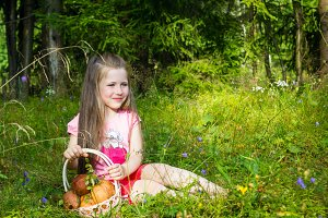 Little girl with mushrooms outdoors