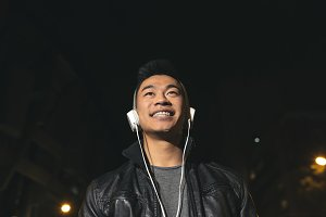 Asian young man listening music.