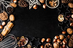Christmas baking background - cookie cutters, spices, nuts, Holiday decorations