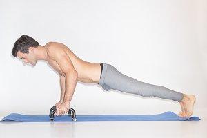 young man exercise push ups bar