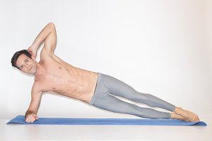 young man abs core exercise