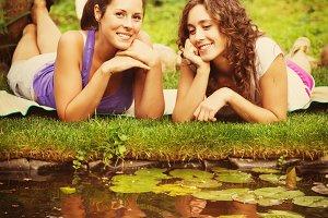 Two women near pond
