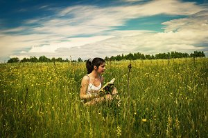 Woman with book outdoors
