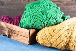 Winter womans woolen clothes heap