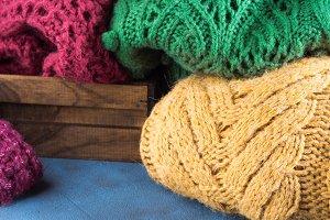 Heap of womans woolen sweaters. Closeup
