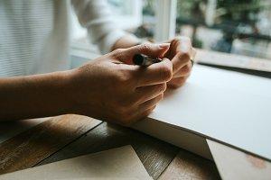 Hands holding a pen