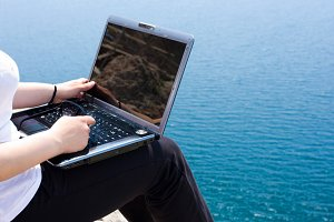 laptop near the sea