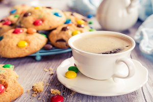 Cup coffee with homemade cookies