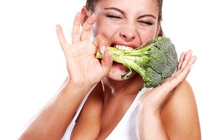 woman with fresh raw broccoli