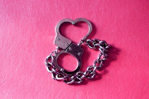 metal handcuffs in shape of heart