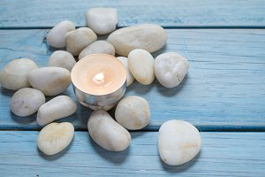 pebbles and candle