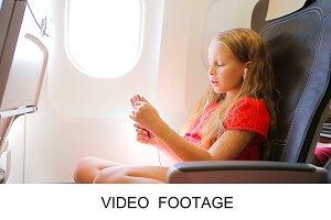 Kid listening music in airplane