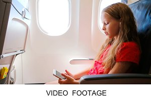 Cute girl listen music in airplane
