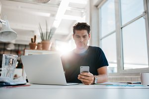 Businessman reading text message