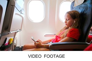 Girl sending message in airplane