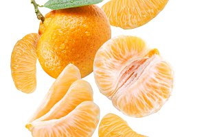 Falling tangerine and tangerine slices. Isolated on a white background.