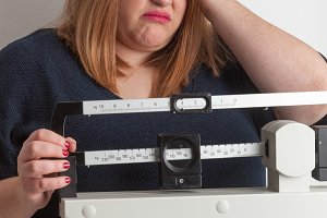 Worried woman on the scale