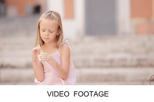 Little girl enjoy italian gelato