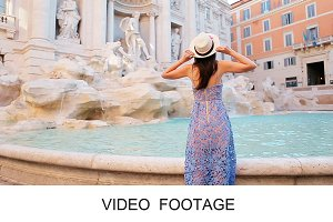 Young beauty woman Fontana di Trevi