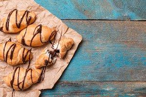 Fresh croissants over wooden background
