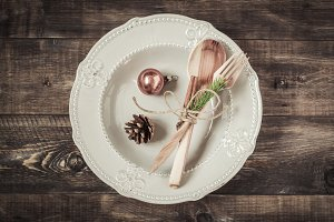 Wooden cutlery on the plate