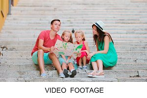 Family of four with touristic map