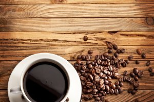 Cup of coffee. View from above on a wooden surface.