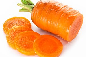 Fresh cut carrot isolated on a white