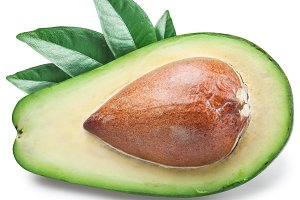 Slice of avocado with leaves.