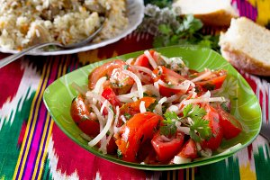 Fresh salad with tomatoes, onions