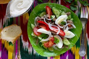 salad with beef, tomatoes, cucumber