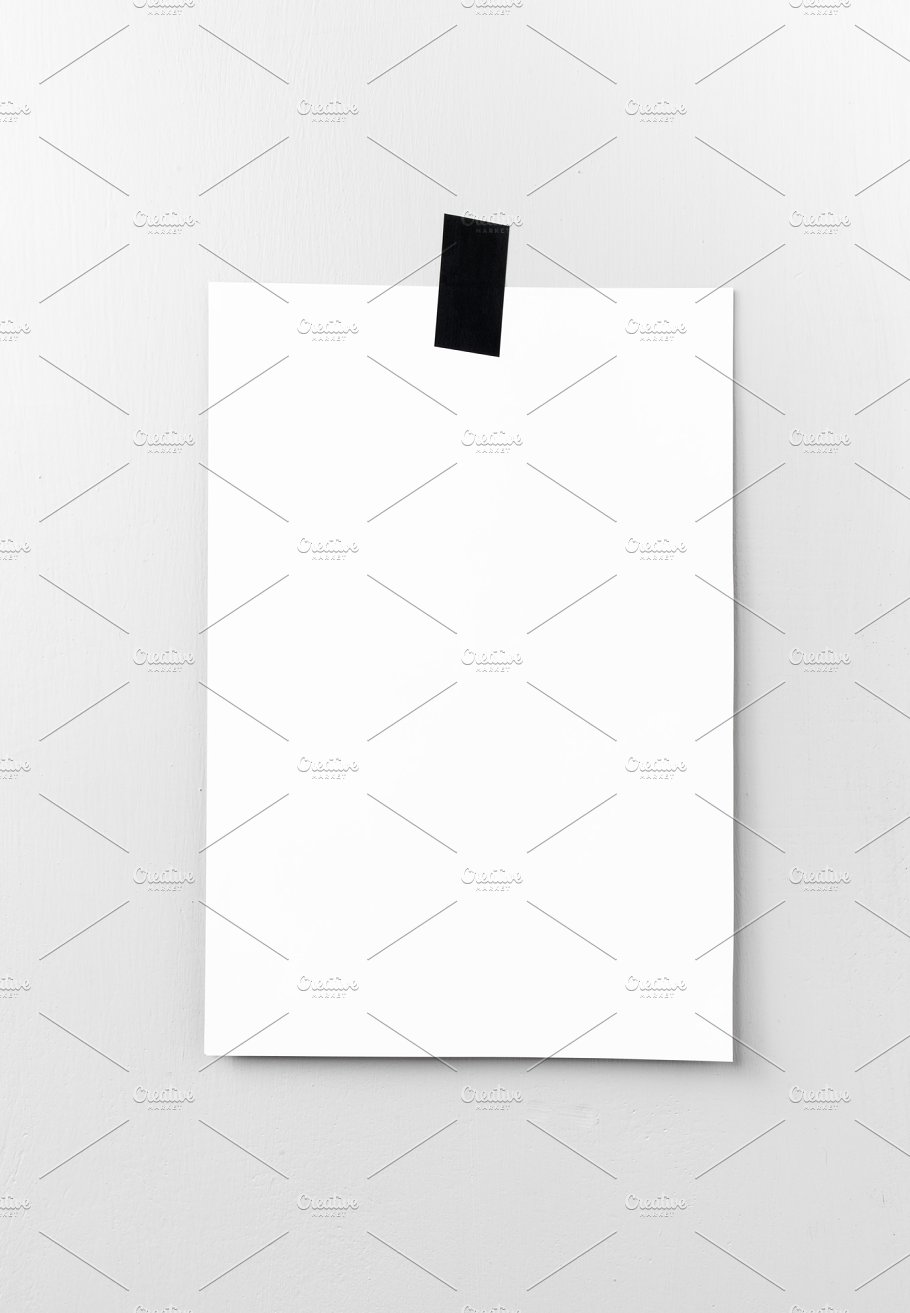 blank white poster hanging on a tape on the wall template backg