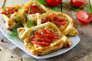 Cakes with red fish and tomatoes